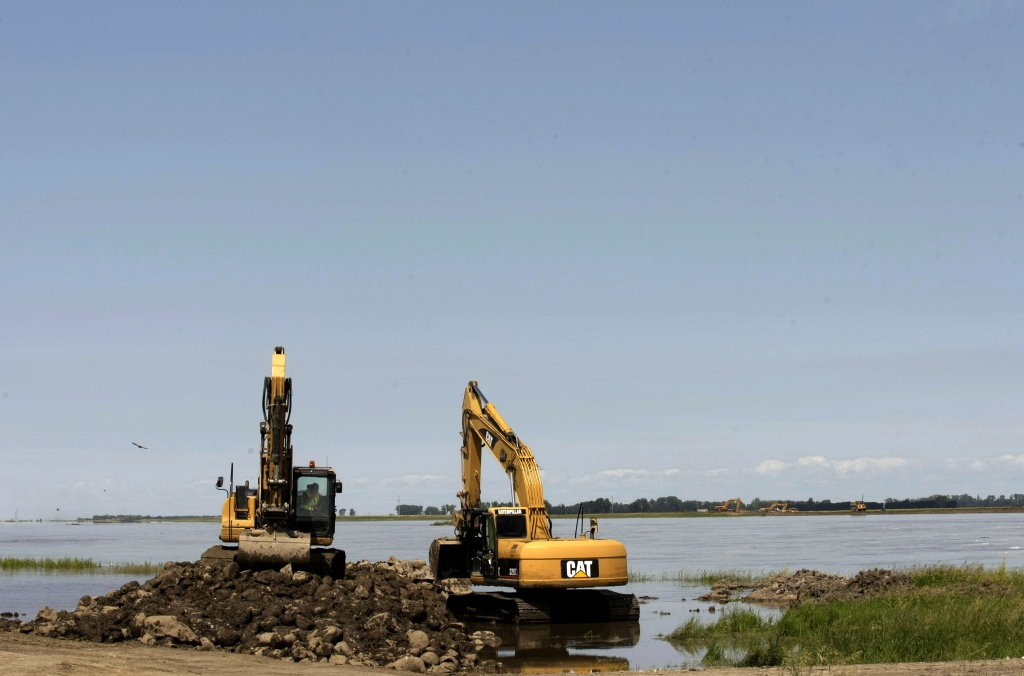 Dozens of pieces of heavy machinery work on the Portage diversion of the Assiniboine river in Portage La Prairie