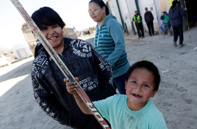 Boys play some road hockey at the command centre for searchers looking for the remains of Teresa Robinson on the Garden Hill First Nation Manitoba, May 23, 2015. Lyle Stafford for the Globe and Mail